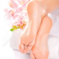 37399492-Foot-massage-in-the-spa-salon-with-orchid-Stock-Photo